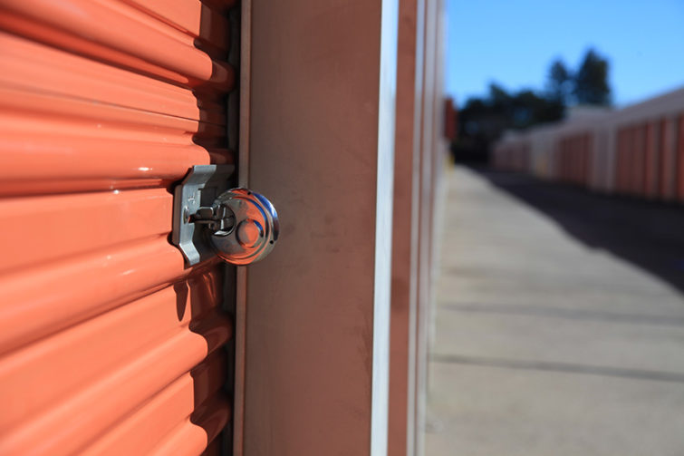 photo of padlock on orange storage container door
